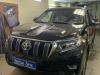 Toyota Land Cruiser Prado 150 tonirovanie stekol, ustanovka zamka na KPP Fortus, setki v bamper, signalizacii StarLine E96